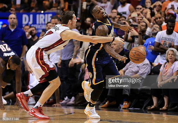 Rodney Stuckey of the Indiana Pacers is fouled by Goran Dragic of the Miami Heat during a game at American Airlines Arena on January 4 2016 in Miami...