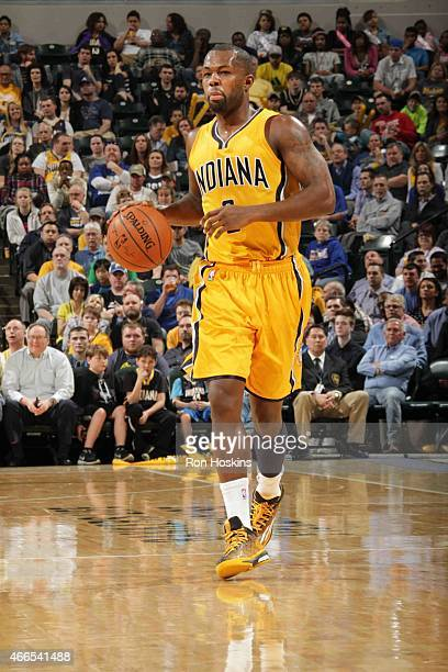 Rodney Stuckey of the Indiana Pacers looks to move the ball against the Toronto Raptors during the game on March 16 2015 at Bankers Life Fieldhouse...