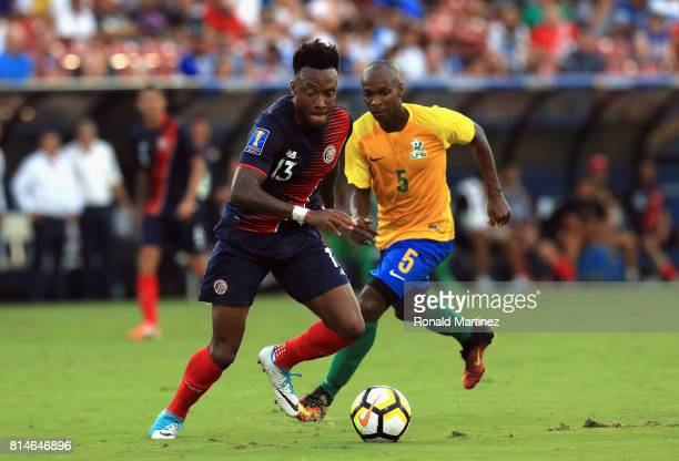 Rodney Wallace of Costa Rica dribbles the ball against Cedric Fabien of French Guiana during the 2017 CONCACAF Gold Cup at Toyota Stadium on July 14...