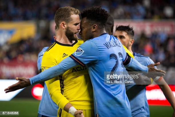 Rodney Wallace of New York City FC tries to make his case to Josh Williams of Columbus Crew get into it during the Audi MLS Eastern Conference...