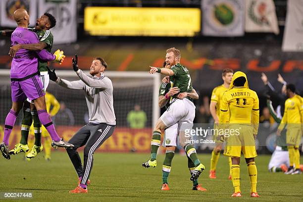 Rodney Wallace of the Portland Timbers celebrates with goalkeeper Adam Kwarasey of the Portland Timbers while Nat Borchers of the Portland Timbers...