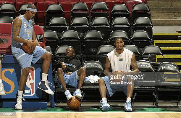 Rodney White Earl Boykins and Jeff Trepagnier of the Denver Nuggets relax before practice between game one and two of the first round of the 2004 NBA...