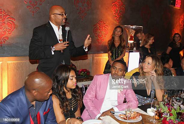 Rodney Williams SVP of Hennessy speaks as Nas and Mariah Carey look on at Nas 40th Birthday Celebration Dinner And Party at Avenue NYC on September...