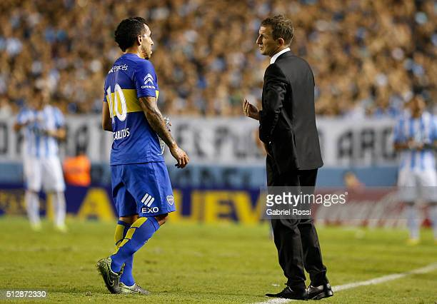 Rodolfo Arruabarrena coach of Boca Juniors gives instructions to Carlos Tevez of Boca Juniors during a fifth round match between Racing Club and Boca...