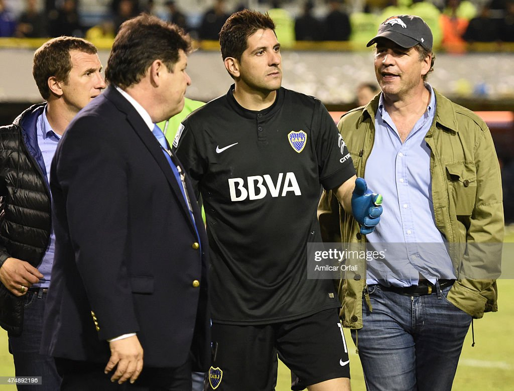 Rodolfo Arruabarrena head coach of Boca Juniors (L), Conmebol delegate Roger Bello of Bolivia (black suit), Agustin Orion goalkeeper of Boca Juniors (black shirt) and Alejandro Burzaco president of Torneos (right) talk moments before the suspension of the Copa Bridgestone Libertadores match between Boca Juniors and River Plate at Alberto J. Armando Stadium on May 14, 2015 in Buenos Aires, Argentina. On May 27, 2015 a United States Justice Department accused nine FIFA officials and five corporate executives of racketeering, wire fraud and money laundering conspiracy. Burzaco has a position in the FIFA Sports Marketing department and is one of the three Argentines accused of paying 150 million dollars in bribes in exchange for mass media and commercialisation rights for international tournaments.