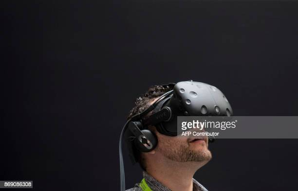 Rodolfo Campos uses a virtual reality headset during a NASA Hybrid Reality Lab demonstration at the NVIDIA GPU Technology Conference which showcases...