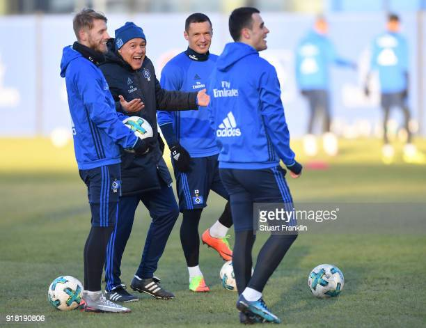 Rodolfo Cardoso assistant coach of Hamburg jokes with Aaron Hunt Sejad Salihovic and Filip Kostic during a training session of Hamburger SV at...