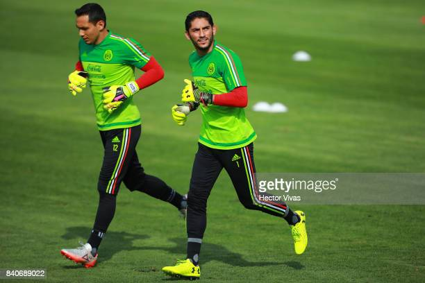 Rodolfo Cota and Jesus Corona goalkeepers of Mexico run during a training session at Centenario Stadium on August 28 2017 in Cuernavaca Mexico