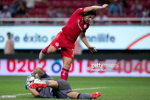 Rodolfo Cota goalkeeper of Chivas dives for the ball as Gabirel Hauche of Toluca tries to score during the 1st round match between Chivas and Toluca...