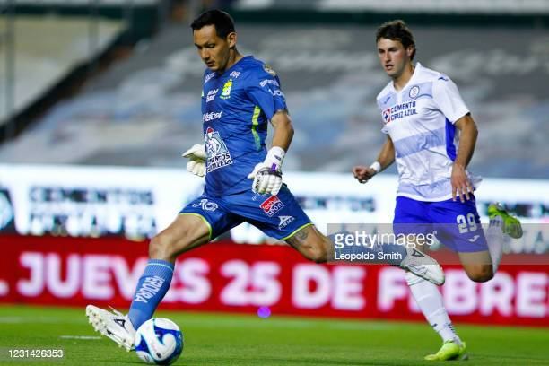 Rodolfo Cota goalkeeper of Leon competes for the ball with Santiago Gimenez of Cruz Azul during the 8th round match between Leon and Cruz Azul as...