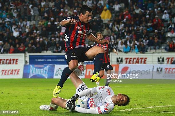 Rodolfo Cota of Pachuca struggles for the ball with Esteban Paredes of Atlante during a match between Pachuca v Atlante as parte of the Clausura 2013...