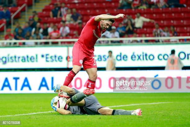 Rodolfo Cota the goalkeaper of Guadalajara vies for the ball with Gabriel Hauche of Toluca during Mexican Apertura 2017 Tournament football match at...