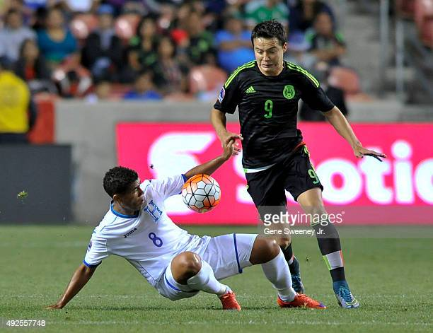 Rodolfo Espinal of Honduras and Erick Torres of Mexico try for the ball in the first half of the final CONCACAF Olympic Qualifying match at Rio Tinto...
