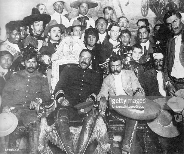 Rodolfo Fierro stands by as Pancho Villa chats with Emiliano Zapata at Mexico City Tomas Urbina is seated at far left Otilio Montano is seated to the...