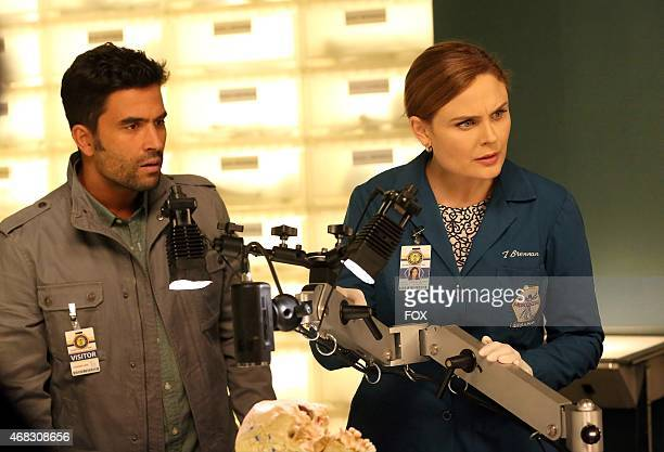 Rodolfo Fuentes and Brennan examine evidence in the 'The Psychic in the Soup' Spring Premiere episode of BONES airing Thursday March 26 on FOX