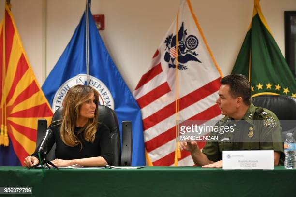 Rodolfo Karisch Chief Patrol Agent TCA Border Patrol confers with US First Lady Melania Trump during a roundtable discussion at the US Customs and...