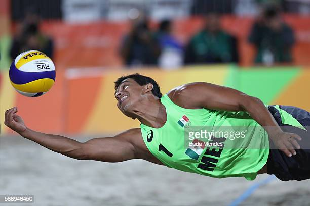 Rodolfo Lombardo Ontiveros Gomez of Mexico stretches for the ball during the Men's Round of 16 match against Reinder Nummerdor and Christiaan...