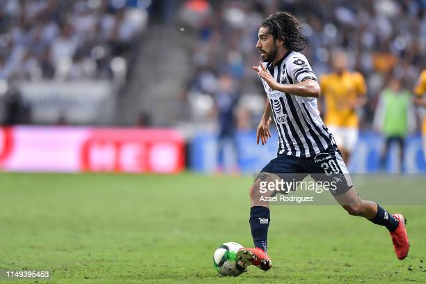 Rodolfo Pizarro #20 of Monterrey drives the ball during the semifinals first leg match between Monterrey and Tigres UANL as part of the Torneo...