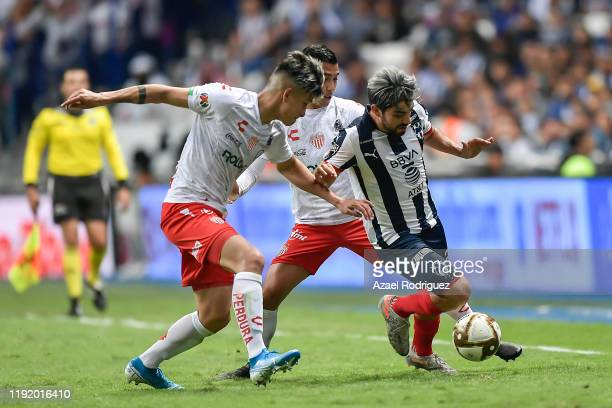 Rodolfo Pizarro #20 of Monterrey fights for the ball with Alexis Peña #4 of Necaxa during the Semifinals first leg match between Monterrey and Necaxa...