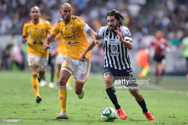 Rodolfo Pizarro #20 of Monterrey fights for the ball with Guido Pizarro #19 of Tigres during the semifinals first leg match between Monterrey and...