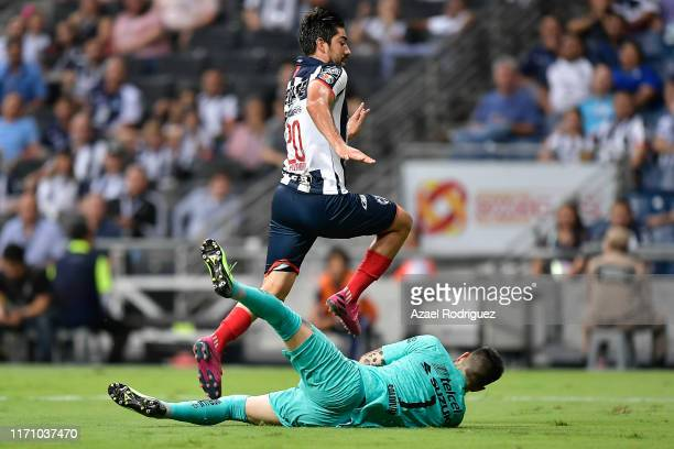 Rodolfo Pizarro #20 of Monterrey jumps over Alfredo Saldívar #1 of Pumas during the 7th round match between Monterrey and Pumas UNAM as part of the...