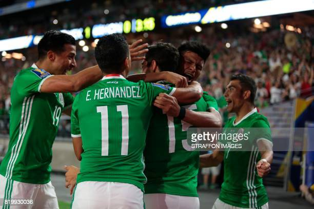 Rodolfo Pizarro celebrates after scoring the opening goal during the CONCACAF Gold Cup 2017 quarterfinal match between Mexico and Honduras at...