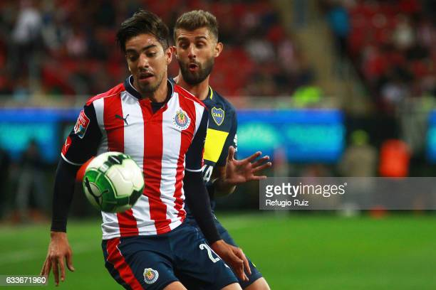 Rodolfo Pizarro of Chivas and Gino Peruzzi of Boca Juniors fight for the ball during a friendly match between Chivas of Mexico against Boca Juniors...