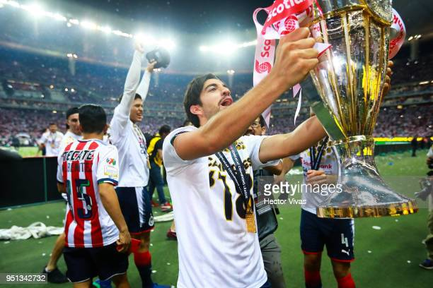 Rodolfo Pizarro of Chivas celebrates with the champions trophy after the second leg match of the final between Chivas and Toronto FC as part of...