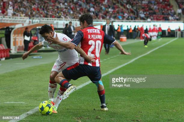 Rodolfo Pizarro of Chivas fights for the ball with Antonio Naelson of Toluca during the 9th round match between Chivas and Toluca as part of the...