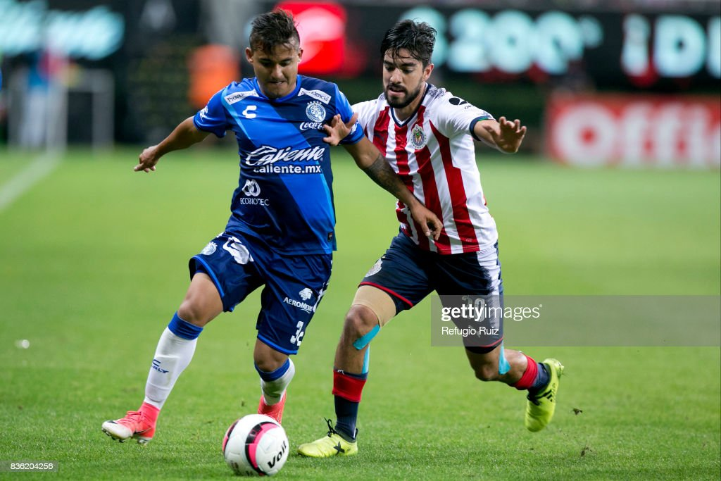 Rodolfo Pizarro of Chivas fights for the ball with Carlos Gutierrez of Puebla during the fifth round match between Chivas and Puebla as part of the Torneo Apertura 2017 Liga MX at Chivas Stadium on August 19, 2017 in Zapopan, Mexico.