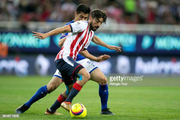 Rodolfo Pizarro of Chivas fights for the ball with Francisco Silva of Cruz Azul during the 2nd round match between Chivas and Cruz Azul as part of...