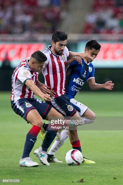 Rodolfo Pizarro of Chivas fights for the ball with Luis Esqueda of Queretaro during the seventh round match between Chivas and Queretaro as part of...