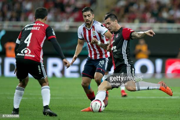 Rodolfo Pizarro of Chivas fights for the ball with Milton Caraglio ofAtlas during the 16th round match between Chivas and Atlas as part of the Torneo...