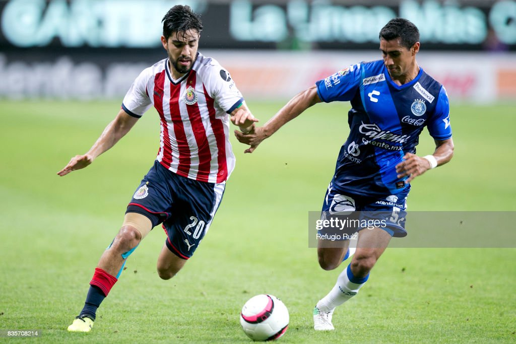 Rodolfo Pizarro of Chivas fights for the ball with Patricio Araujo of Puebla during the fifth round match between Chivas and Puebla as part of the Torneo Apertura 2017 Liga MX at Chivas Stadium on August 19, 2017 in Zapopan, Mexico.