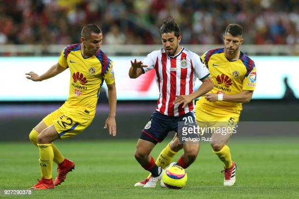Rodolfo Pizarro of Chivas fights for the ball with Paul Aguilar of America during the 10th round match between Chivas and America as part of the...
