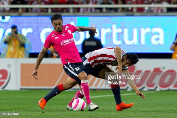Rodolfo Pizarro of Chivas fights for the ball with Rodrigo Millar of Morelia during the 13th round match between Chivas and Morelia as part of the...
