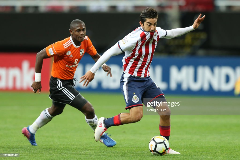 Rodolfo Pizarro of Chivas fights for the ball with Tafarel Ferreira of Cibao during the match between Chivas and Cibao as part of the round of 16th of the CONCACAF Champions League at Akron Stadium on February 28, 2018 in Zapopan, Mexico.