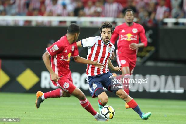 Rodolfo Pizarro of Chivas fights for the ball with Tyler Adams of New York RB during the semifinal match between Chivas and New York RB as part of...