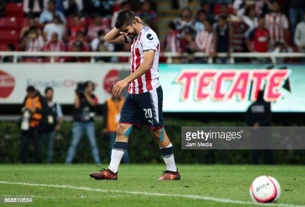 Rodolfo Pizarro of Chivas reacts after missing a penalty kick in the penalty series during the quarter final match between Chivas and Atlante as part...