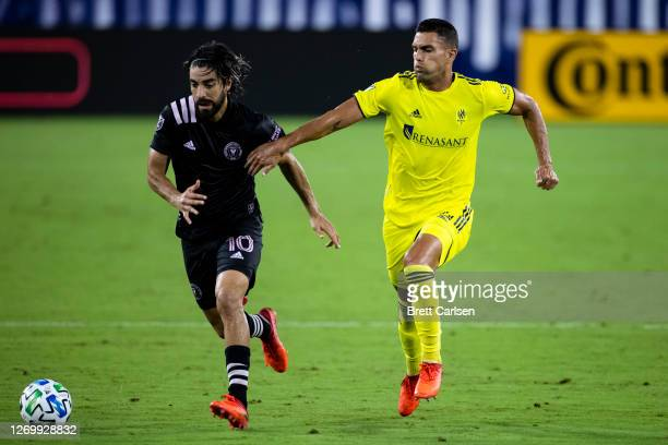 Rodolfo Pizarro of Inter Miami and Daniel Rios of Nashville SC vie for the ball during the second half at Nissan Stadium on August 30, 2020 in...