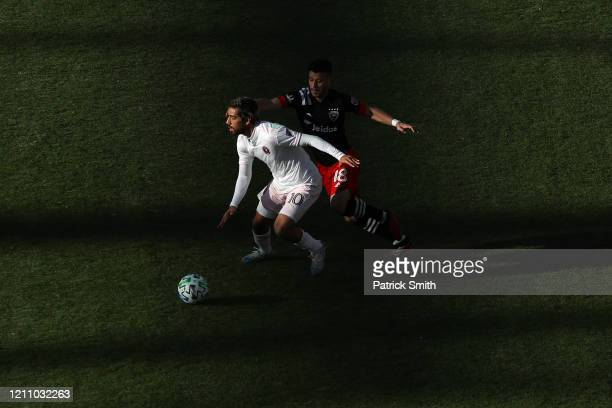 Rodolfo Pizarro of Inter Miami and Felipe Martins of DC United battle for the ball during the first half at Audi Field on March 7 2020 in Washington...