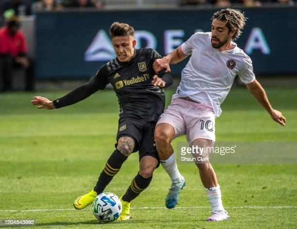 Rodolfo Pizarro of Inter Miami battles Eddie Segura of Los Angeles FC during their MLS match against Inter Miami at the Banc of California Stadium on...
