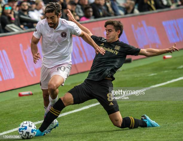 Rodolfo Pizarro of Inter Miami battles Francisco Ginella of Los Angeles FC during their MLS match against Inter Miami at the Banc of California...