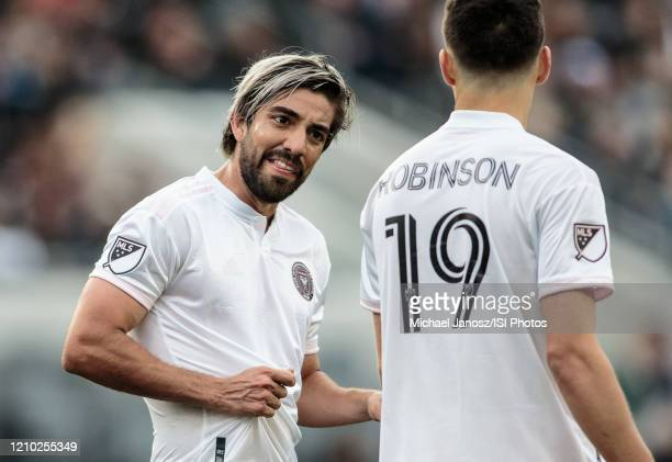 Rodolfo Pizarro of Inter Miami CF has a few words with teammate Robbie Robinson during a game between Inter Miami CF and Los Angeles FC at Banc of...