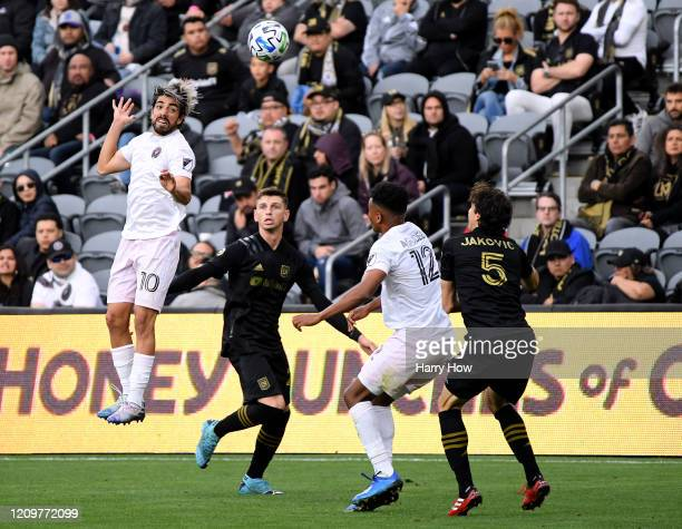 Rodolfo Pizarro of Inter Miami CF heads the ball in front of Drake Callender of Inter Miami CF Juan Agudelo and Dejan Jakovic during the second half...
