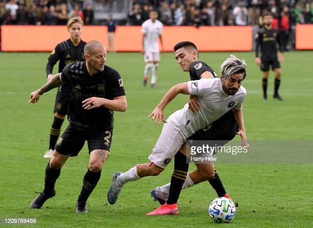 Rodolfo Pizarro of Inter Miami CF is taken down by Eduard Atuesta of Los Angeles FC as Jordan Harvey looks on during the second half in a 10 Los...