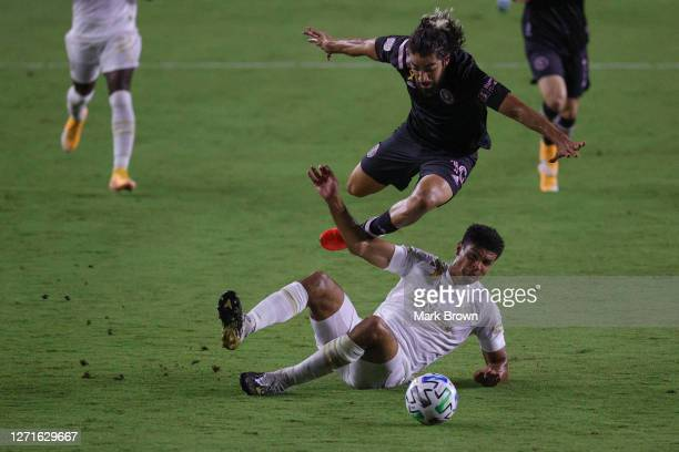 Rodolfo Pizarro of Inter Miami CF tries to avoid the slide tackle by Miles Robinson of Atlanta United FC during a game at Inter Miami CF Stadium on...