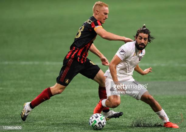 Rodolfo Pizarro of Inter Miami controls the ball in font of Jeff Larentowicz of Atlanta United during a game at Mercedes-Benz Stadium on September...