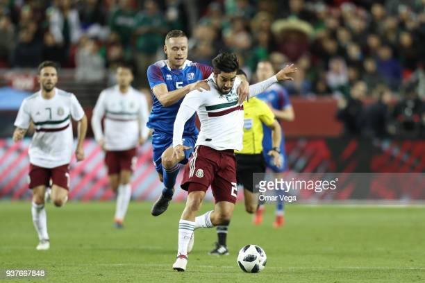 Rodolfo Pizarro of Mexico and Sverrir Ingi Ingason of Iceland fight for the ball during the friendly match between Mexico and Iceland at Levi's...
