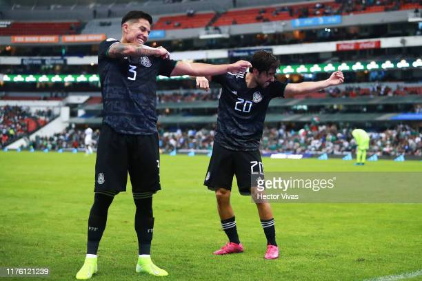 Rodolfo Pizarro of Mexico celebrates with teammate after scoring the third goal of his team during the match between Mexico and Panama as part of the...